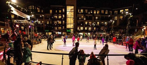 Aspen Snowmass base village new ice rink with ice skaters