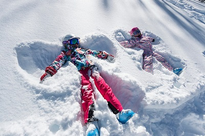 Deer Valley family ski trip with kids snow angels