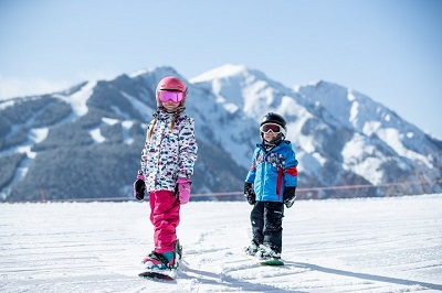 Snowmass family friendly resort kids learn to snowboard