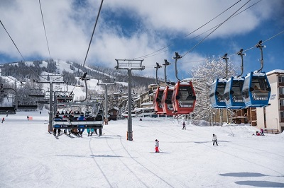 Snowmass lifts the skittles people mover from Snowmass base village to the mall